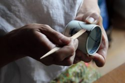 Mio Heki kintsugi repairing ceramic cup in studio Kyoto Japan close-up